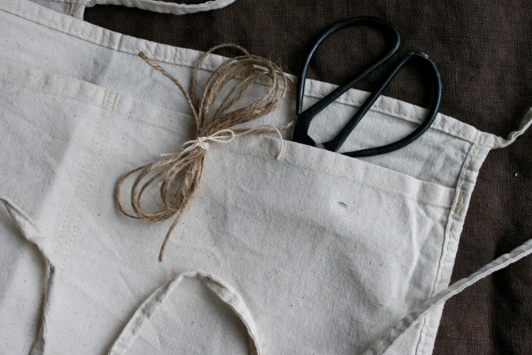 I like these plain canvas carpenter aprons.