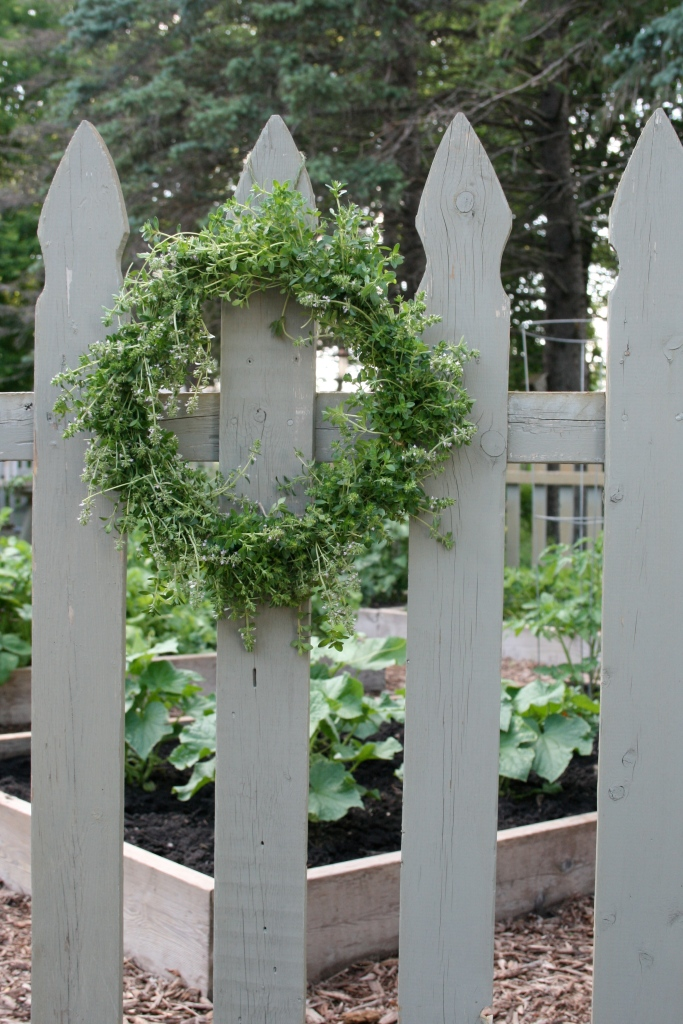 Maybe the garden gate needs a little wreath.