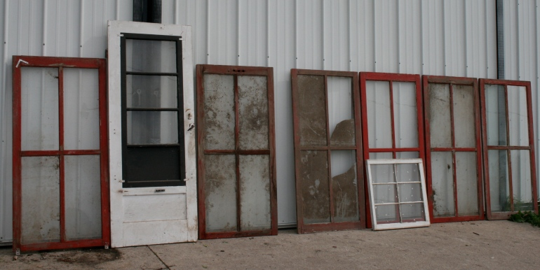 A collection of old windows purchased at a farm auction served as the start of the greenhouse layout.