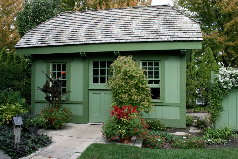 The famous green shed, tucked into the test garden.