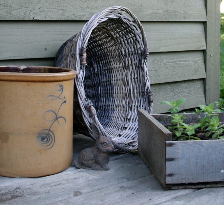 Baskets, crocks and old crates make nice garden containers.